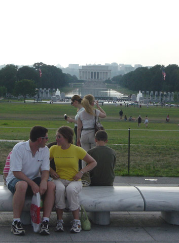Corey + Jenelle on a bench.
