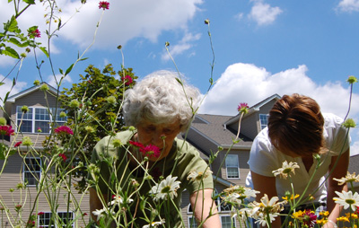 Grandma & Jenelle in the garden, dead-heading.